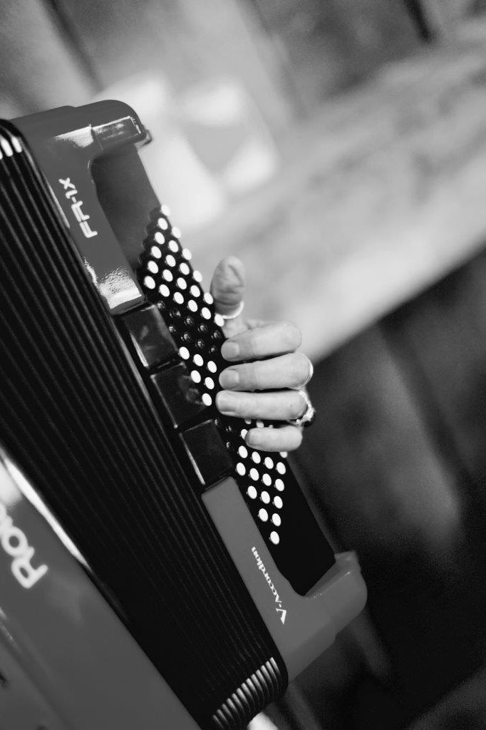 evermore weddings accordion closeup with hand