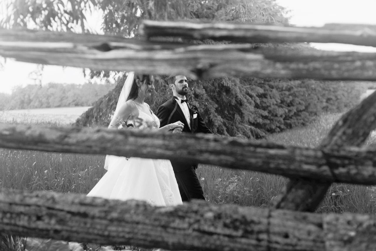 evermore weddings bride groom through fence