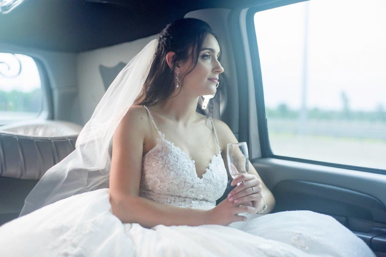evermore weddings bride in car with empty glass