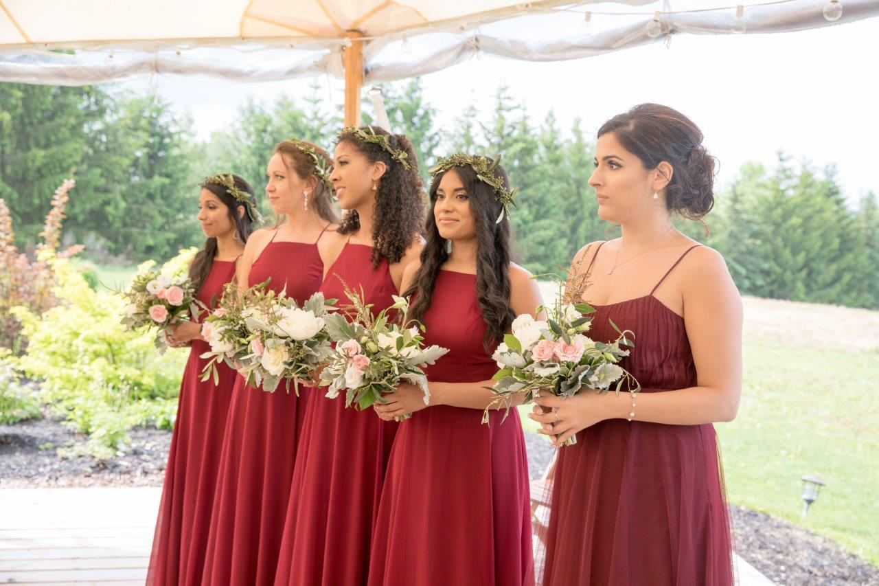 evermore weddings bridesmaids in red