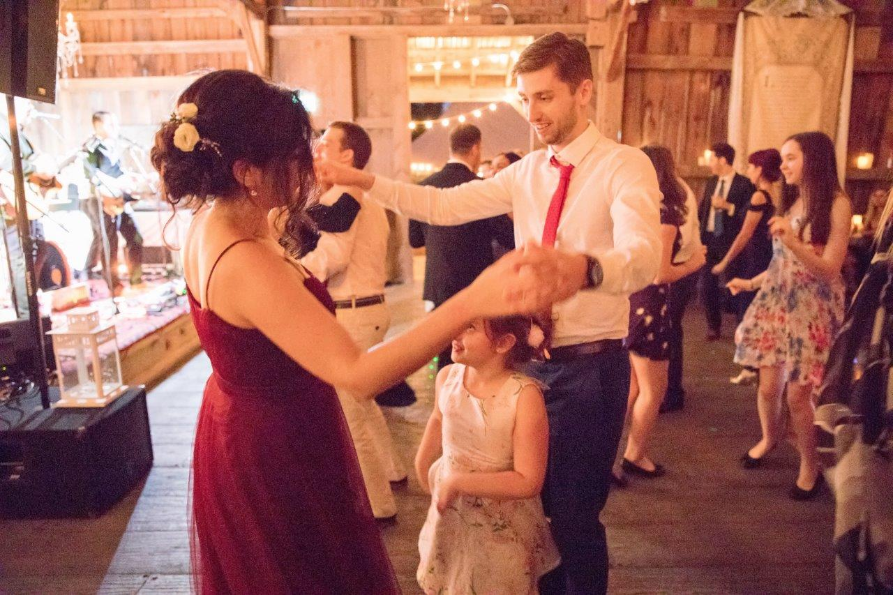 evermore weddings couple dance with child
