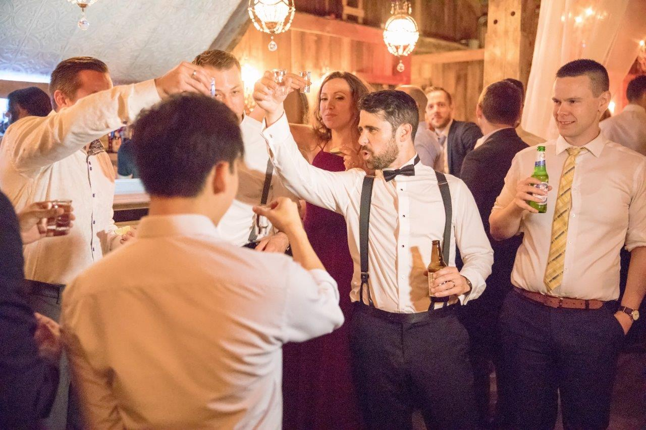 evermore weddings groom and groomsmen toast