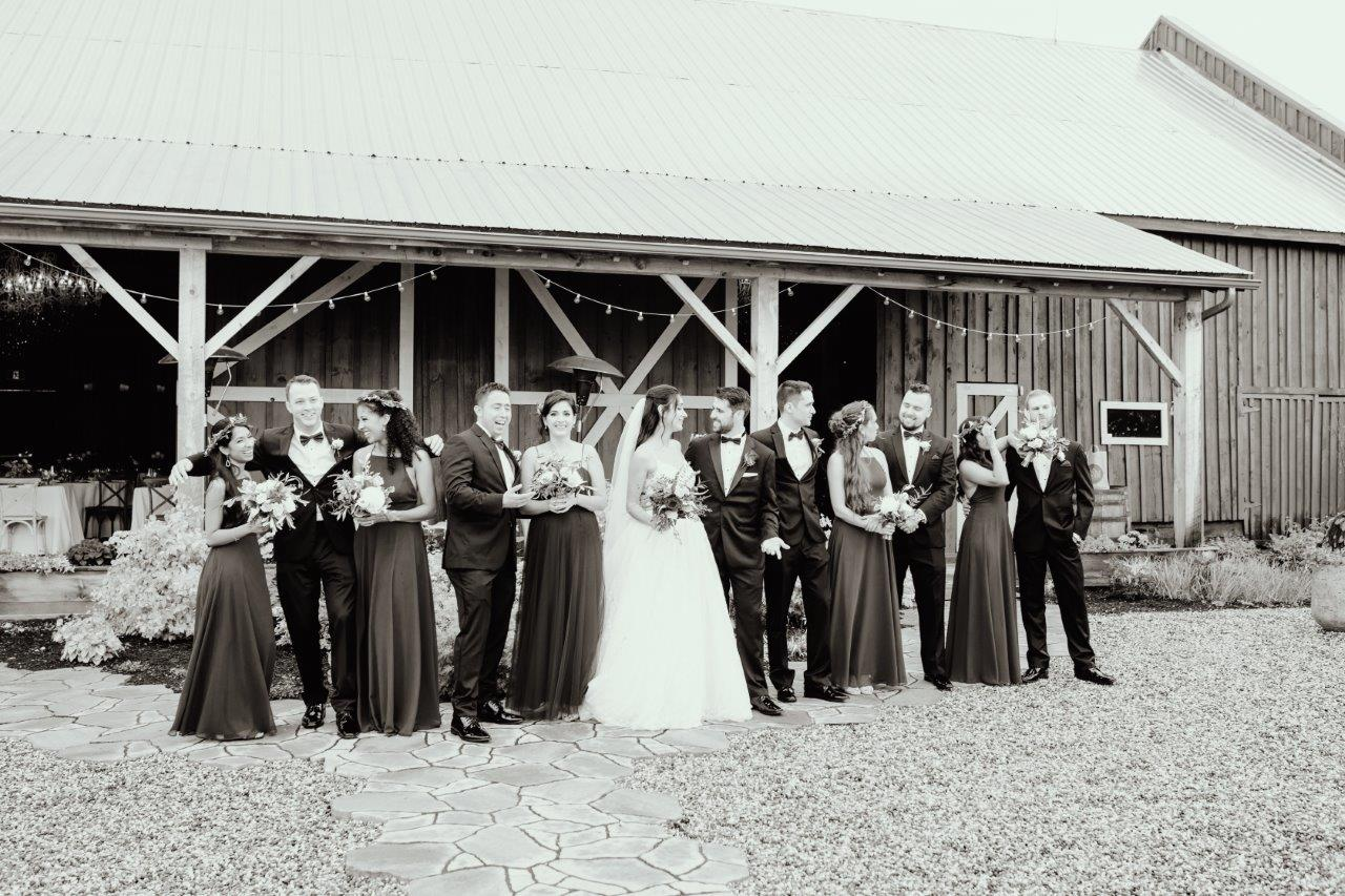 evermore weddings wedding party in front of barn