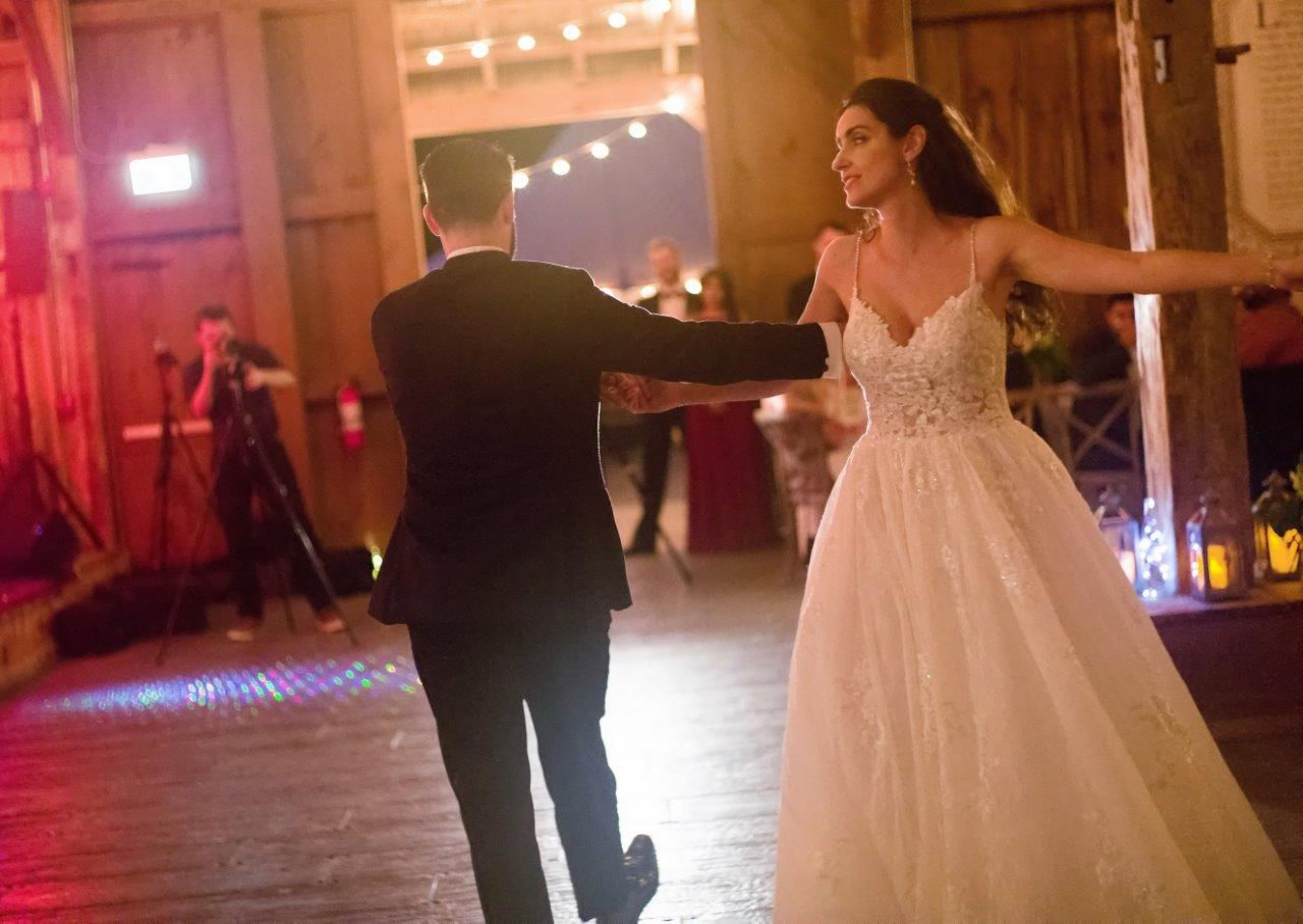 kathi robertson evermore weddings bride groom dancing