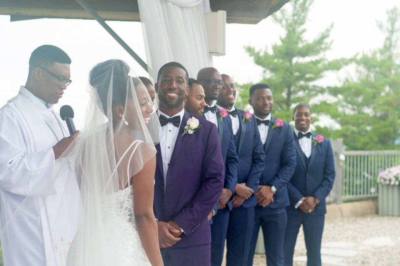 kathi robertson wedding le belvedere alter shot groom smiling with groomsmen