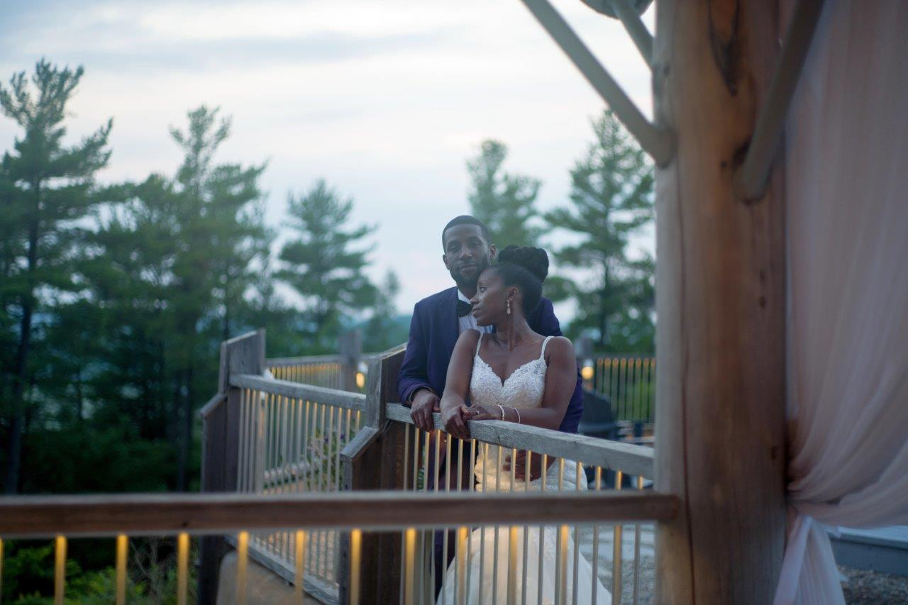 kathi robertson wedding le belvedere bride groom on balcony candid