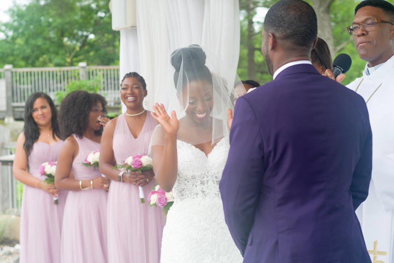 kathi robertson wedding le belvedere bride laughing with bridal party alter