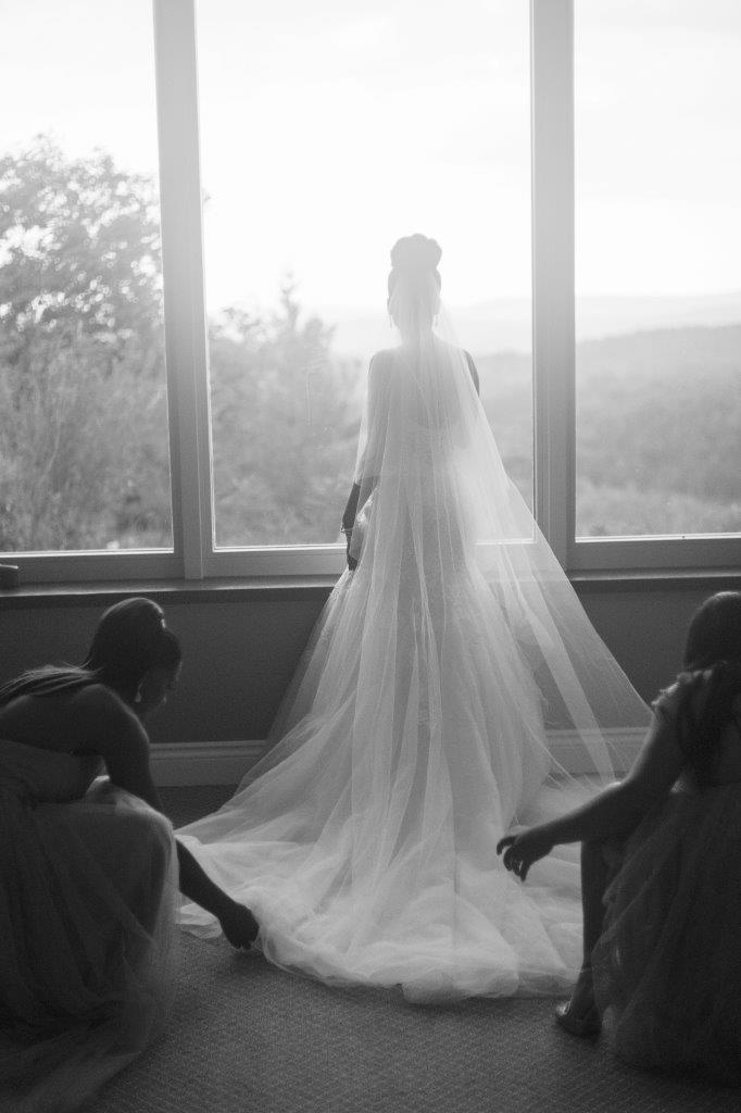 kathi robertson wedding le belvedere bride looking out window landscape