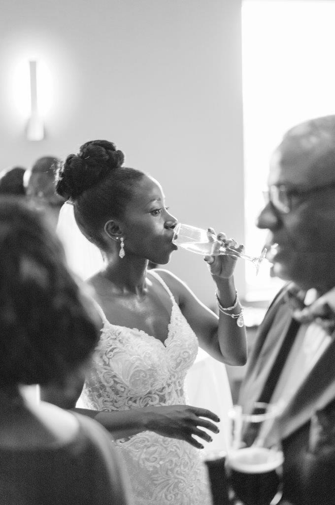 kathi robertson wedding le belvedere bride sipping champagne