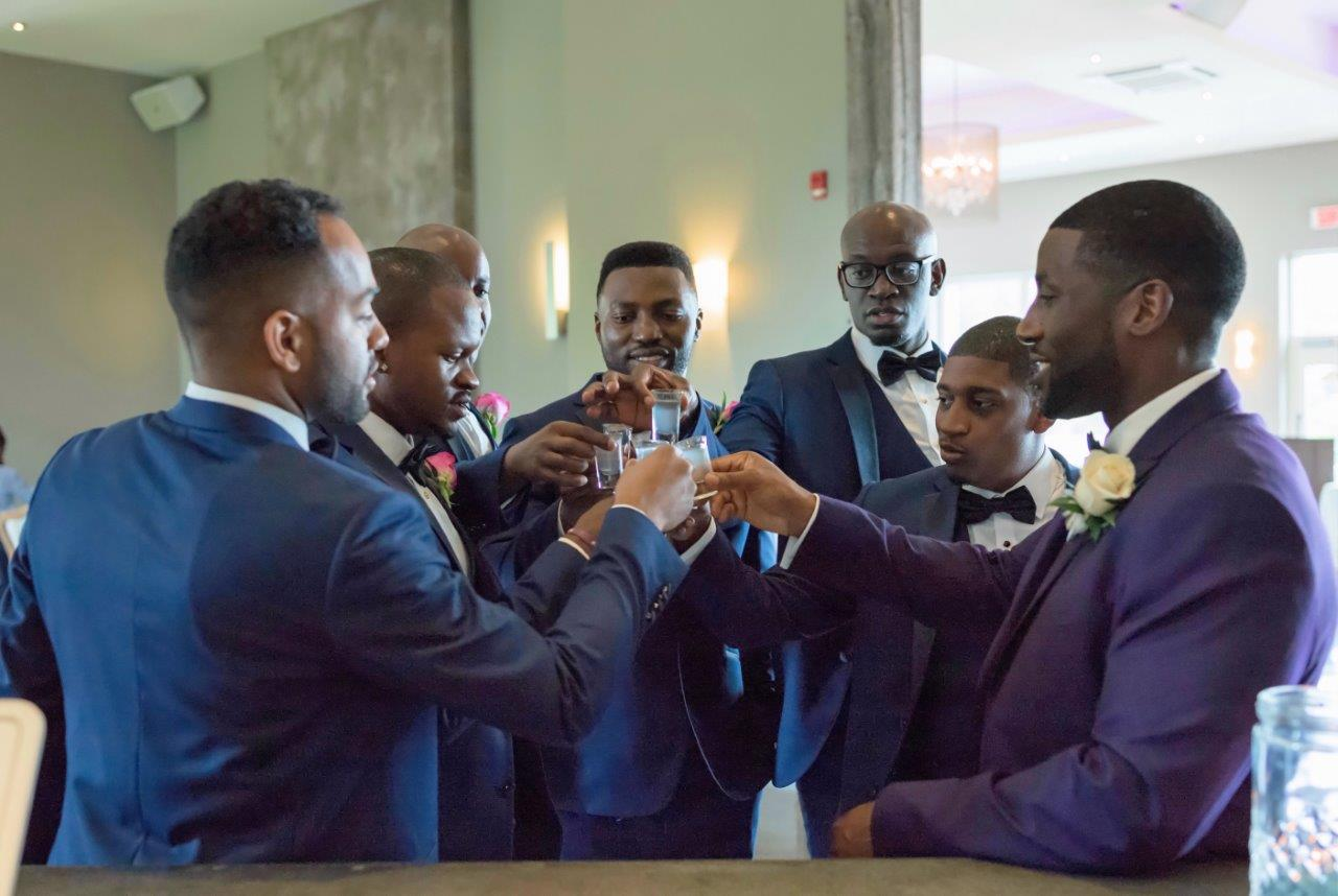 kathi robertson wedding le belvedere groomsmen cheering