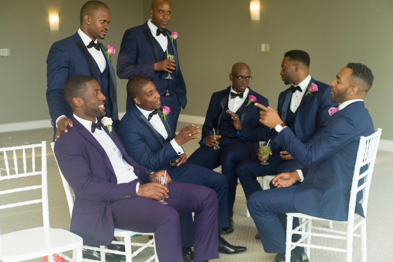 kathi robertson wedding le belvedere groomsmen some seated candid chat