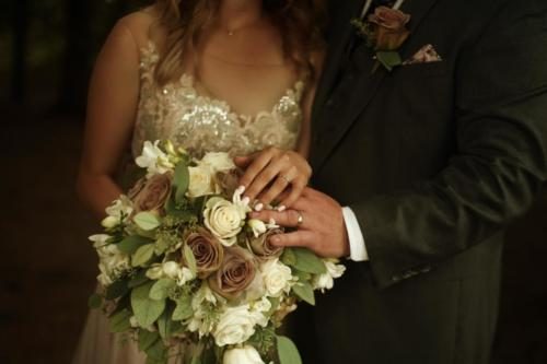 couple holding gorgeous rose bouquet